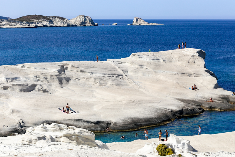 White landscape surrounded by water on Sarakiniko Beach in Milos, Greece