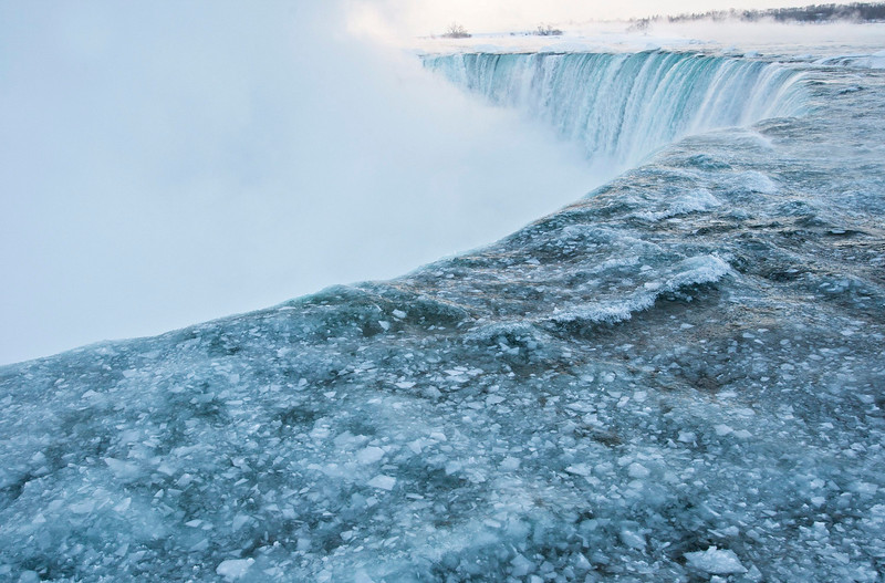 . Pieces of ice flow over the Canadian \'Horseshoe\' Falls in Niagara Falls, Ontario, Canada, Thursday, Feb. 19, 2015. (AP Photo/The Canadian Press,Aaron Lynett)