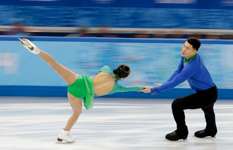 . Peng Cheng and Zhang Hao of China compete in the team pairs short program figure skating competition at the Iceberg Skating Palace during the 2014 Winter Olympics, Thursday, Feb. 6, 2014, in Sochi, Russia. (AP Photo/Bernat Armangue)