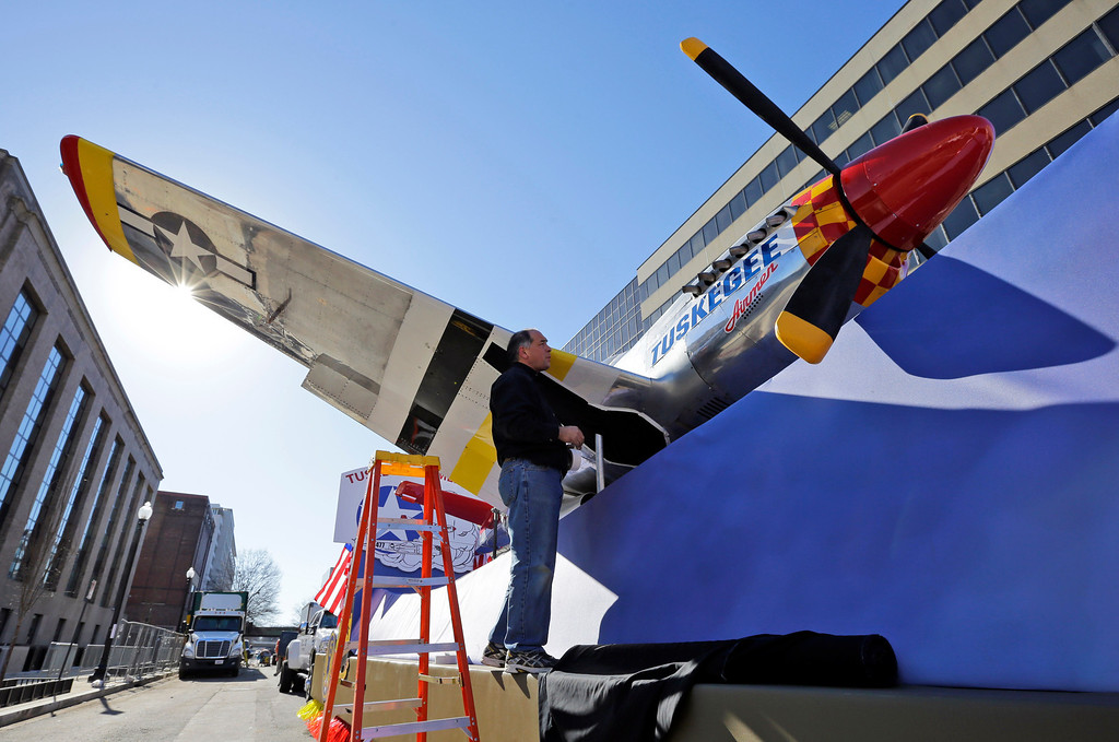 . Kevin Tamai with Hargrove Inc., works on a plane on the Tuskegee Airmen float prepared for the 57th Presidential Inaugural Parade, Sunday, Jan. 20, 2013 in Washington. Thousands are planning to march in the 57th Presidential Inauguration parade after the ceremonial swearing-in of President Barack Obama on Monday. (AP Photo/Alex Brandon)