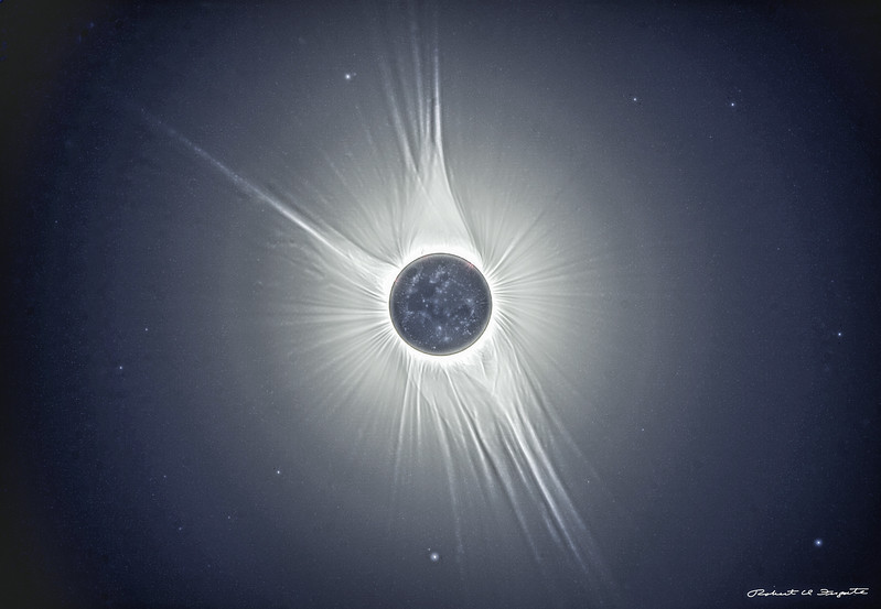 A super-stretched version showing stars in the area surrounding the eclipsed sun.