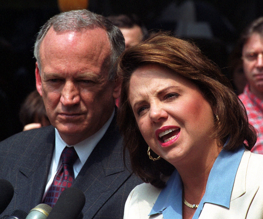 . Patsy Ramsey speaks as her husband John Ramsey listens during a short news conference,Tuesday, Aug. 29, 2000 in Atlanta, after answering questions from Boulder, Colo., police authorities about the death of their daughter, JonBenet. (AP Photo/Gregory Smith)
