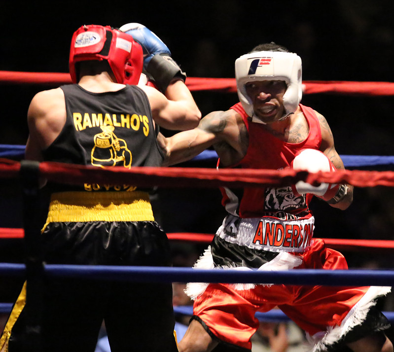 Opening night of 2017 Greater Lowell Golden Gloves. Troy Anderson of Dorchester and Nonantum Boxing Club (Red), right, won 132 lb Novice bout vs  Steve Rao of Lowell and Lowell West End (Blue). (SUN/Julia Malakie)