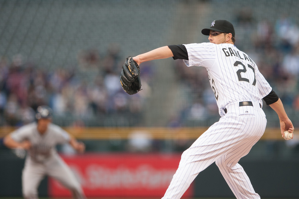 . DENVER, CO - APRIL 6: Jon Garland #27 of the Colorado Rockies pitches in the first inning against the San Diego Padres at Coors Field on April 6, 2013 in Denver, Colorado. The Rockies led 1-0 after the first inning. (Photo by Dustin Bradford/Getty Images)