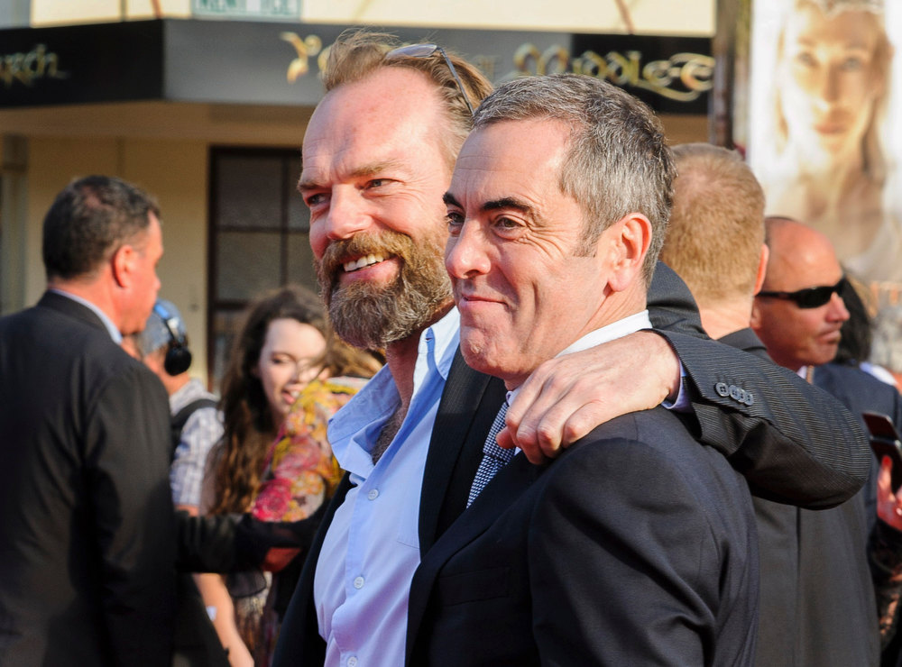 . Actors James Nesbitt (R), who plays the character Bofur, and Hugo Weaving, who plays the character Elrond, pose on the red carpet at the world premier of \'The Hobbit - An Unexpected Journey\' in Wellington November 28, 2012.    REUTERS/Mark Coote