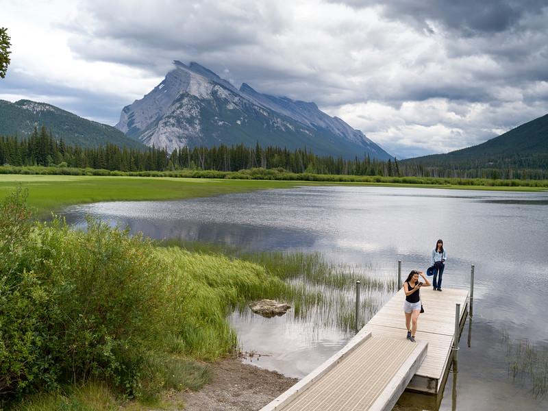 Tourists on pier at lakeside, Vermilion Lake, Mount Rundle, Improvement District 9, Banff National Park, Jasper, Alberta, Canada