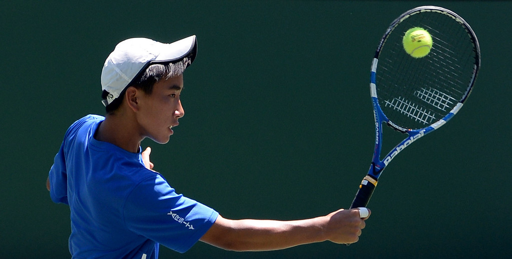 . San Marino\'s Charles Deng returns a shot against University\'s (Irvine) in a doubles match during the CIF State Tennis Championship at the Claremont Club in Claremont, Calif., on Saturday, May 31, 2014. University\'s (Irvine) won 6-2, 6-0.   (Keith Birmingham/Pasadena Star-News)