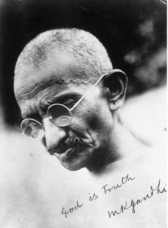 . A signed portrait of Mahatma Gandhi (Mohandas Karamchand Gandhi, 1869 - 1948), leader of the Indian National Congress, circa 1935. He campaigned for tolerance and social reform and an end to discrimination against the so-called untouchable caste. He was assassinated by a Hindu nationalist in the violence that followed the partition of British India into India and Pakistan.  (Photo by General Photographic Agency/Getty Images)