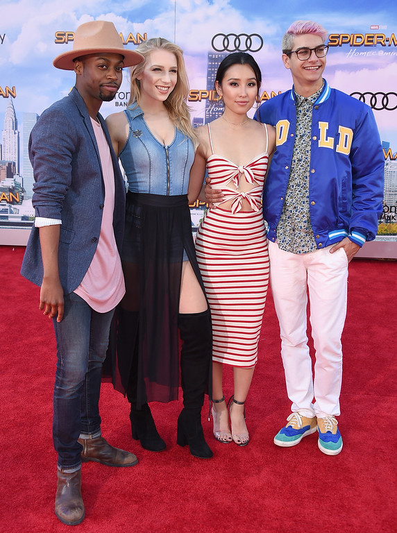 """. Keith Leak Jr, from left, Courtney Miller, Olivia Sui and Noah Grossman arrive at the Los Angeles premiere of \""""Spider-Man: Homecoming\"""" at the TCL Chinese Theatre on Wednesday, June 28, 2017. (Photo by Jordan Strauss/Invision/AP)"""