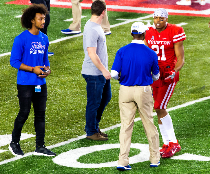 Running back Rowdy Simon stops to chat with a Tulsa assistant.
