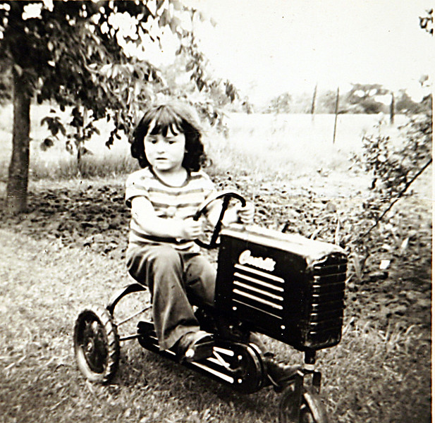 George playing with his tractor.JPG