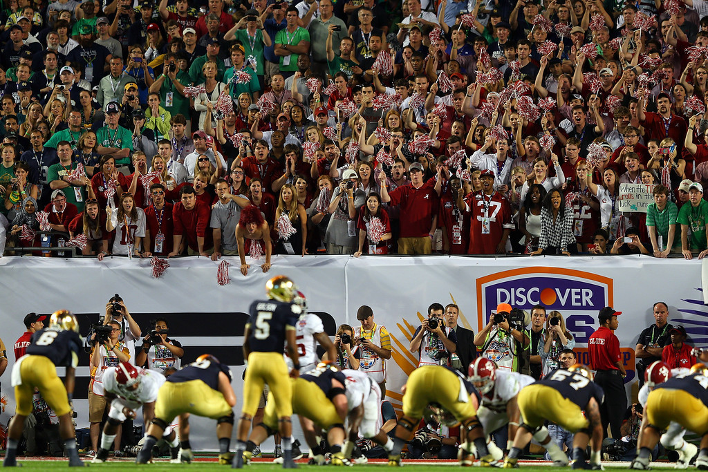 . MIAMI GARDENS, FL - JANUARY 07:  Fans of the Alabama Crimson Tide cheers as Everett Golson #5 of the Notre Dame Fighting Irish lines up behind center during the 2013 Discover BCS National Championship game at Sun Life Stadium on January 7, 2013 in Miami Gardens, Florida.  (Photo by Mike Ehrmann/Getty Images)