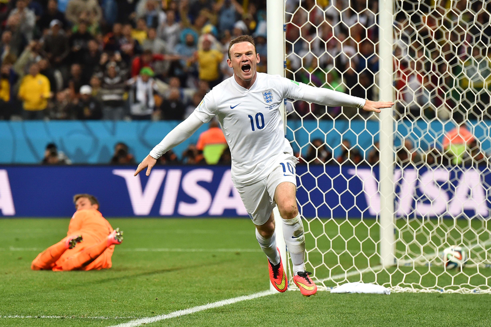 . England\'s forward Wayne Rooney (R) celebrates after scoring past Uruguay\'s goalkeeper Fernando Muslera during the Group D football match between Uruguay and England at the Corinthians Arena in Sao Paulo on June 19, 2014, during the 2014 FIFA World Cup. (BEN STANSALL/AFP/Getty Images)