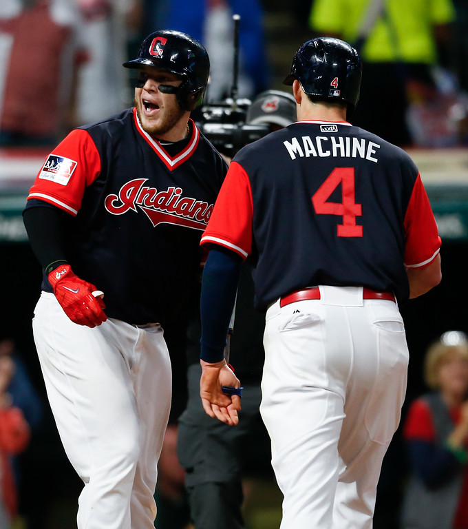 . Cleveland Indians\' Roberto Perez celebrates with Bradley Zimmer (4) after hitting a two run home run off Kansas City Royals starting pitcher Jason Hammel during the sixth inning in a baseball game, Saturday, Aug. 26, 2017, in Cleveland. (AP Photo/Ron Schwane)