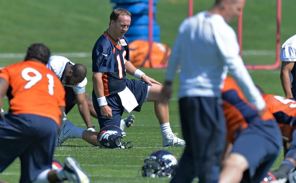 . Peyton Manning (18) of the Denver Broncos stretches during the teams OTAs May 20, 2013 at Dove Valley. All offseason training activities (OTAs) are voluntary until the mandatory minicamp June 11-13. (Photo By John Leyba/The Denver Post)
