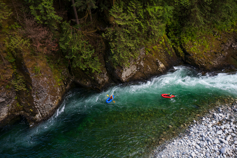 Overhead view of two men packrafting the Chehalis River, British Columbia, Canada.