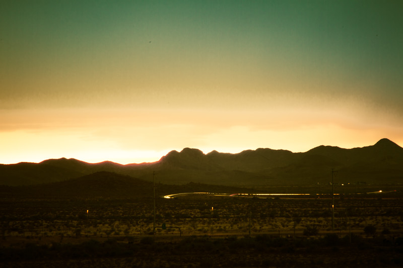 Desert Sunset with Mountains and Clouds
