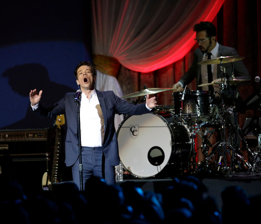 . Fun performs during The Inaugural Ball at the Washington convention center during the 57th Presidential Inauguration in Washington, Monday, Jan. 21, 2013. (AP Photo/Paul Sancya)