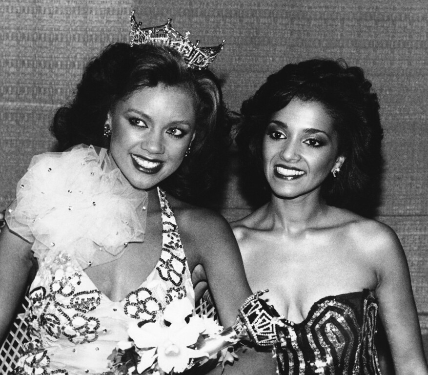 . Miss America of 1984 Vanessa Williams, left, of New York poses with Miss New Jersey Suzette Charles, after Williams was crowned, Sept. 19, 1983 in Atlantic City. (AP Photo)