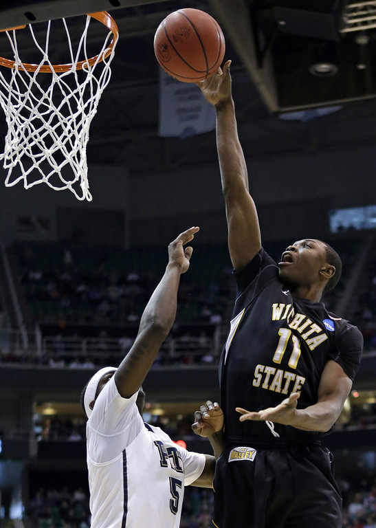 . Wichita State\'s Cleanthony Early (11) shoots over Pittsburgh\'s Durand Johnson (5) during the first half during a second-round game in the NCAA college basketball tournament in Salt Lake City Thursday, March 21, 2013. (AP Photo/Rick Bowmer)