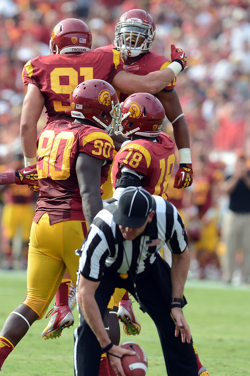 . USC\'s Morgan Breslin #91 and Hayes Pullard #10 celebrate Breslin\'s sack of CAL\'s QB Zach Maynard #15 during their game at Los Angeles Memorial Coliseum September 22, 2012. USC beat CAL 27-9. (Hans Gutknecht/L.A. Daily News)