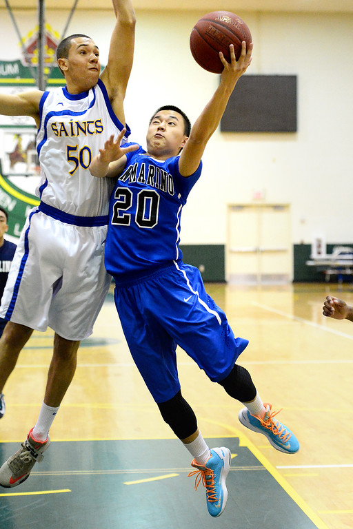 . San Marino\'s Jasper Hwang goes for a shot as San Dimas\'s Jordan Stokes attempts a block during the 10th annual Tribune/Star-News boys/girls basketball all-star classic Friday night, April 26, 2013 at Damien High School in La Verne. (SGVN/Staff Photo by Sarah Reingewirtz)