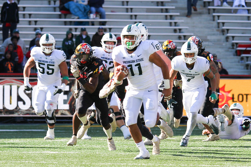 Michigan State RB #11 Connor Heyward breaks away from defenders in a foot race for a touchdown