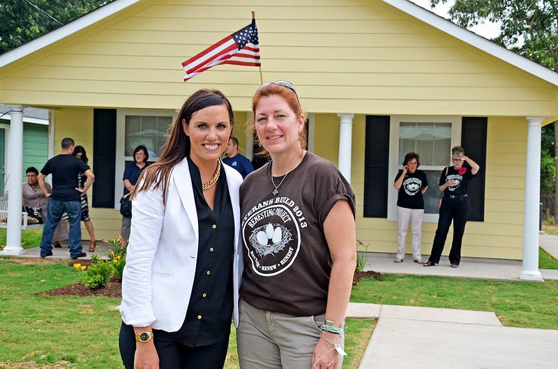 Gail Saetta (right) helped connect donor Roger Waters of Pink Floyd to the 2013 Veterans Build in Shreveport. Waters gave $300,000 for the project.