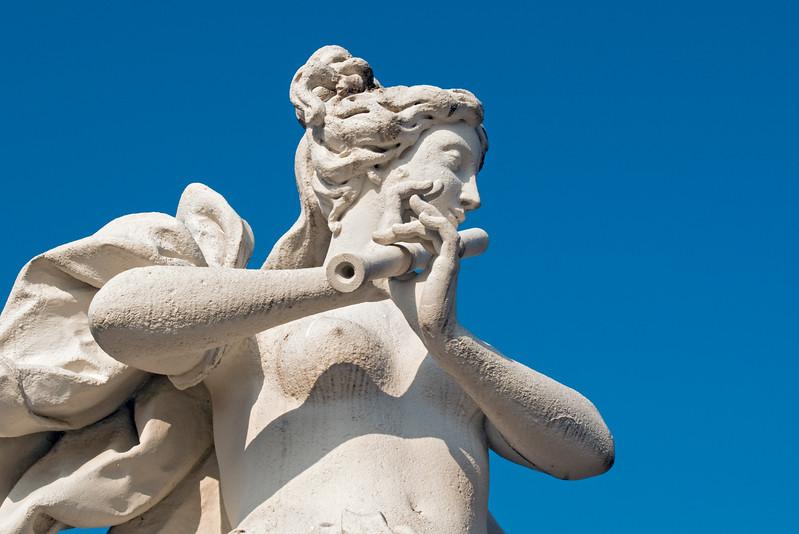 Baroque Sculpture of Flute Player in Belvedere Castle Garden (Belvederegarten), Vienna (Wien), Austria