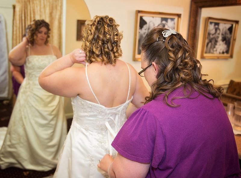 Beth fixing Brides dress.jpg