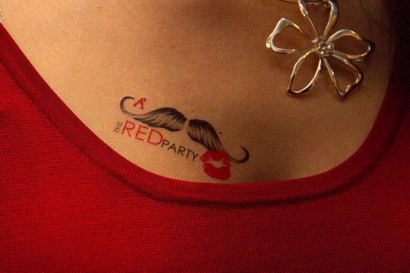 Red Party Tattoo applied while in line