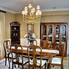 Luxury wooden dining room table and chairs in a modern home.