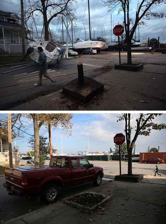 . NEW YORK, NY - NOVEMBER 02: (top) Boats pushed up by Hurricane Sandy lie against residences near a marina on November 2, 2012 in the Staten Island borough of New York City.   NEW YORK, NY - OCTOBER 17:  (bottom)  A truck sits parked near a marina on October 17, 2013 in the Staten Island borough of New York City. Hurricane Sandy made landfall on October 29, 2012 near Brigantine, New Jersey and affected 24 states from Florida to Maine and cost the country an estimated $65 billion.   (Photos by John Moore/Getty Images)