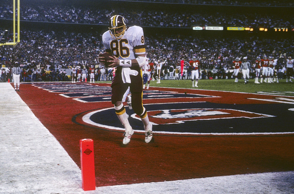 . Tight end Clint Didier #86 of the Washington Redskins scores a touchdown during Super Bowl XXII against the Denver Broncos at Jack Murphy Stadium on January 31, 1988 in San Diego, California.    (Photo by George Rose/Getty Images)