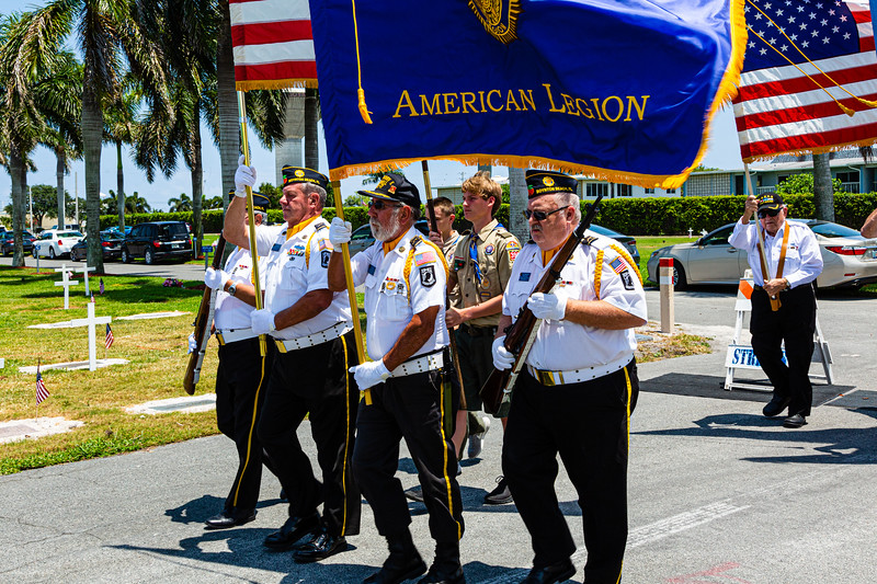 Members of the Boynton Beach Veterans march while presenting the colors during the Memorial Day Observance at Boynton Beach Memorial Park on Sunday, May 26, 2019.  [JOSEPH FORZANO/palmbeachpost.com]
