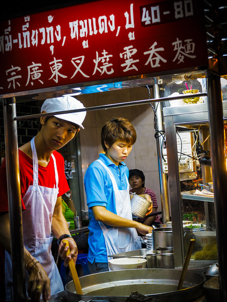 Street life scene in crazy Chinatown of Bangkok at night.