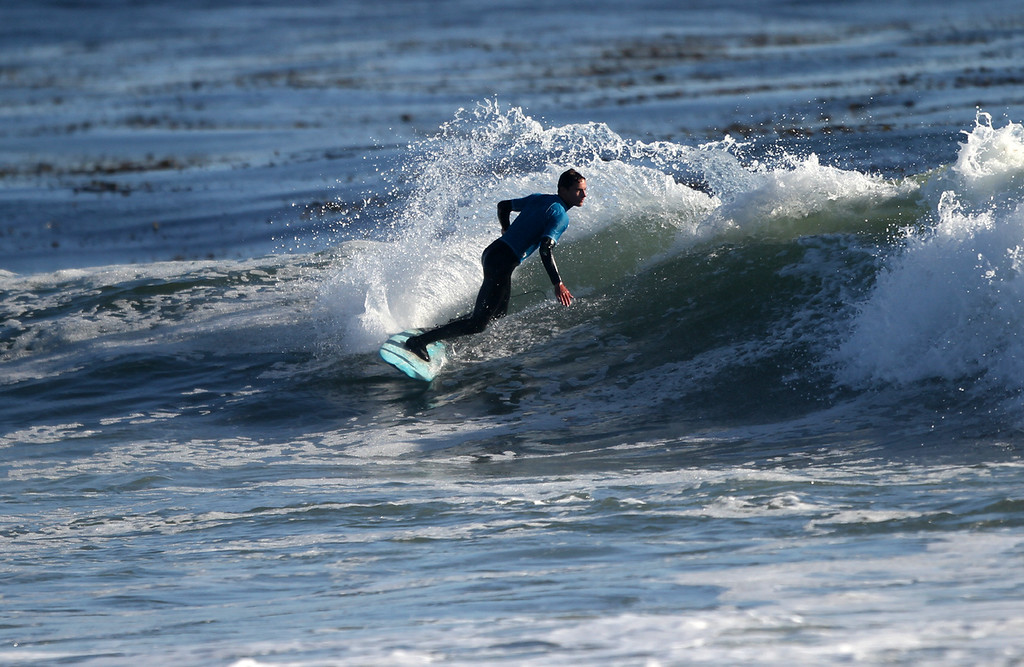 . A competitor makes a turn during the men\'s shortboard final at the Santa Cruz Scholastic Surf League contest at Pleasure Point Sunday, Feb. 24, 2013, in Capitola, Calif. (Jon Weiand/Santa Cruz Sentinel Sentinel)