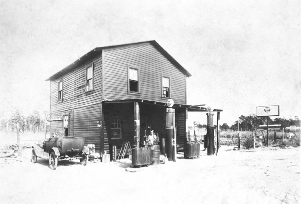 Lillie Winn Breare on porch of country store with gas pumps - Baldwin, Florida ca 1926.jpg