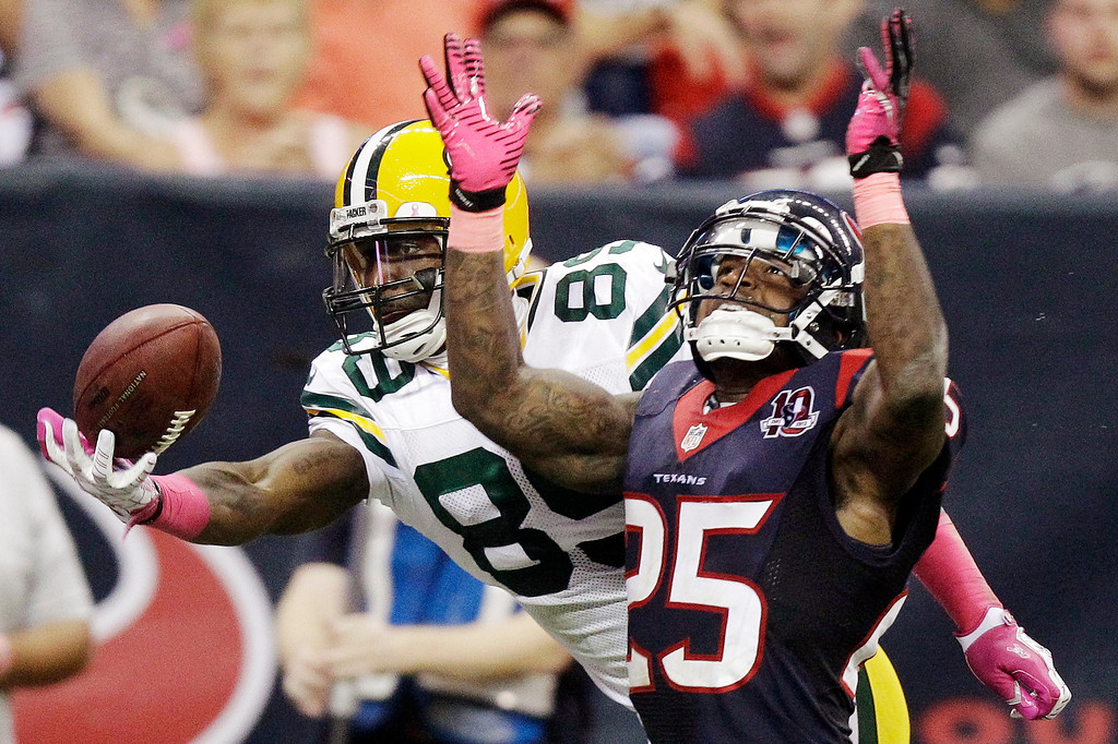 . HOUSTON TEXANS - Green Bay Packers wide receiver James Jones (89) makes a touchdown reception against Houston Texans cornerback Kareem Jackson (25) in the fourth quarter of an NFL football game, Sunday, Oct. 14, 2012, in Houston.   (AP Photo/Patric Schneider)