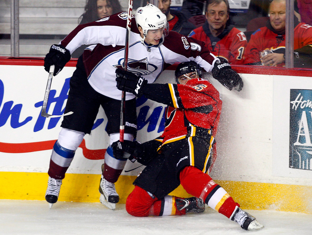 . Colorado Avalanche\'s Matt Duchene, left, slams Calgary Flames\' Mark Giordano into the boards during the first period of an NHL hockey game Thursday, Jan. 31, 2013, in Calgary, Alberta. (AP photo/The Canadian Press, Jeff McIntosh)