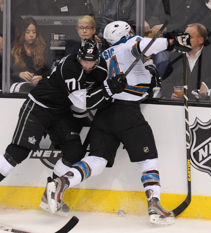 . The Kings\' Jeff Carter is called for a penalty after charging into the Sharks Marc-Edouard Vlasic in the second period, Thursday, May 16, 2013, at Staples Center. (Michael Owen Baker/Staff Photographer)
