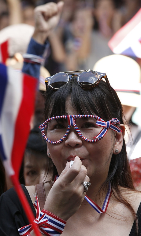 . Thai anti-government protesters blow whistles and rally at the start of a march on the US embassy in Bangkok, Thailand, 29 November 2013.  EPA/BARBARA WALTON