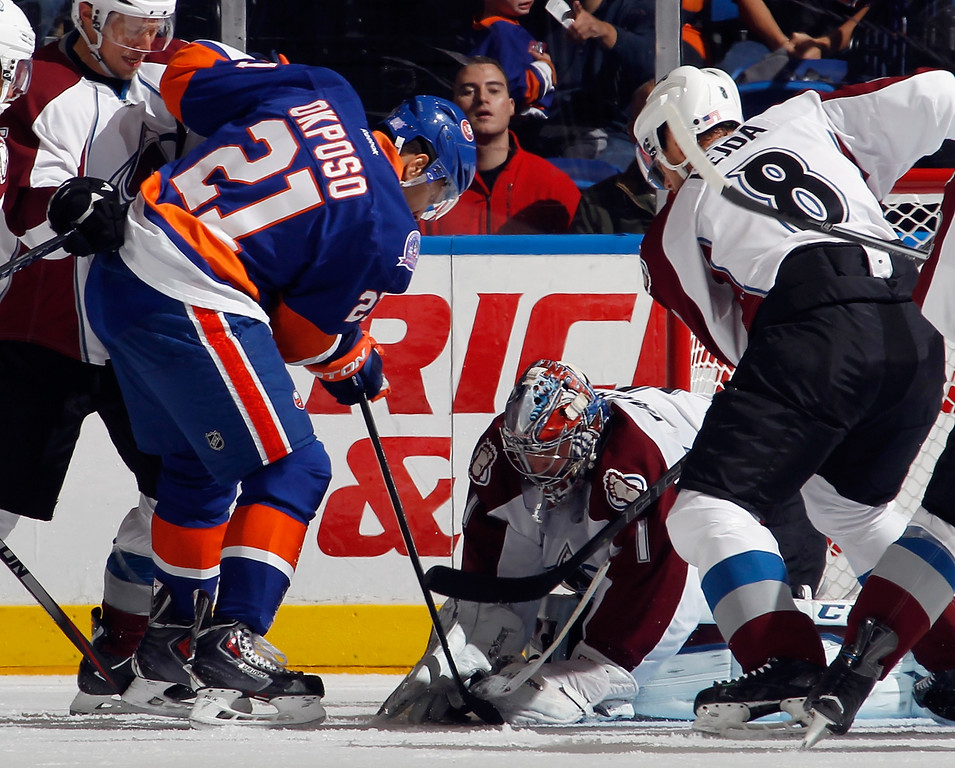 . UNIONDALE, NY - NOVEMBER 11: Semyon Varlamov #1 of the Colorado Avalanche makes the first period stop on Kyle Okposo #21 of the New York Islanders at the Nassau Veterans Memorial Coliseum on November 11, 2014 in Uniondale, New York.  (Photo by Bruce Bennett/Getty Images)