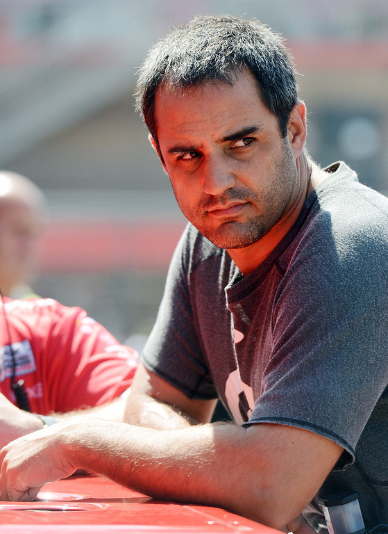 . (Will Lester/Staff Photographer) NASCAR driver Juan Pablo Montoya waits in the garage for his car to be prepared during the opening practice session for Sunday\'s Auto Club 400 Friday March 22, 2013.