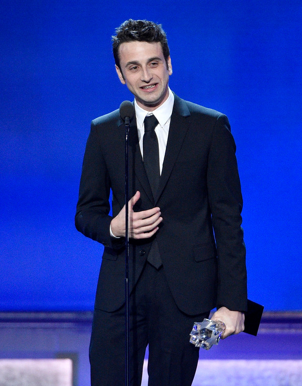 """. Justin Hurwitz accepts the award for best song for \""""City of Stars\"""" from \""""La La Land\"""" at the 22nd annual Critics\' Choice Awards at the Barker Hangar on Sunday, Dec. 11, 2016, in Santa Monica, Calif. (Photo by Chris Pizzello/Invision/AP)"""