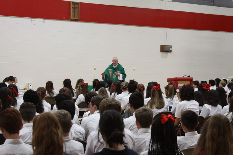 Monsignor Roger Smith addresses IWA Middle Level students, faculty, and staff on May 19 during a school Mass in honor of the Mother of God.