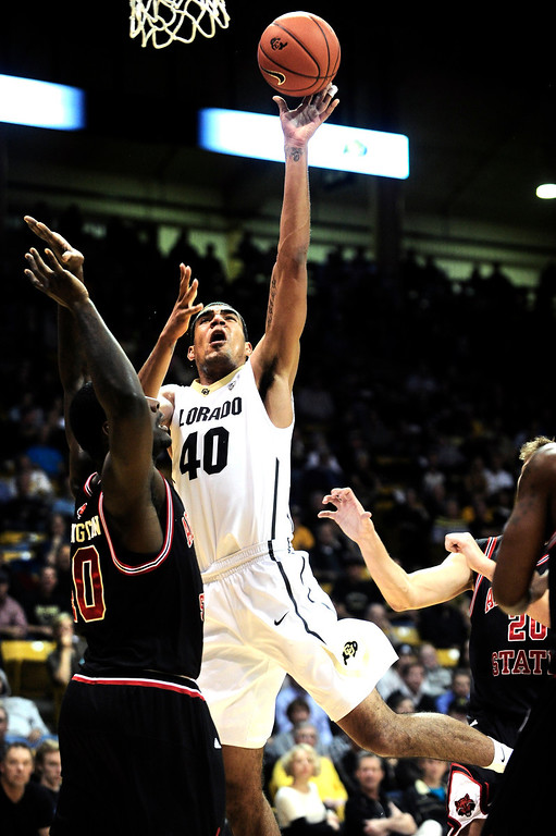 . University of Colorado\'s Josh Scott (40) drive against Arkansas State\'s Kendrick Washington (40) during their game at the Coors Events Center on the CU Boulder Campus in Boulder, Colorado on November 18, 2013.  Photo by Paul Aiken / The Boulder Daily Camera.