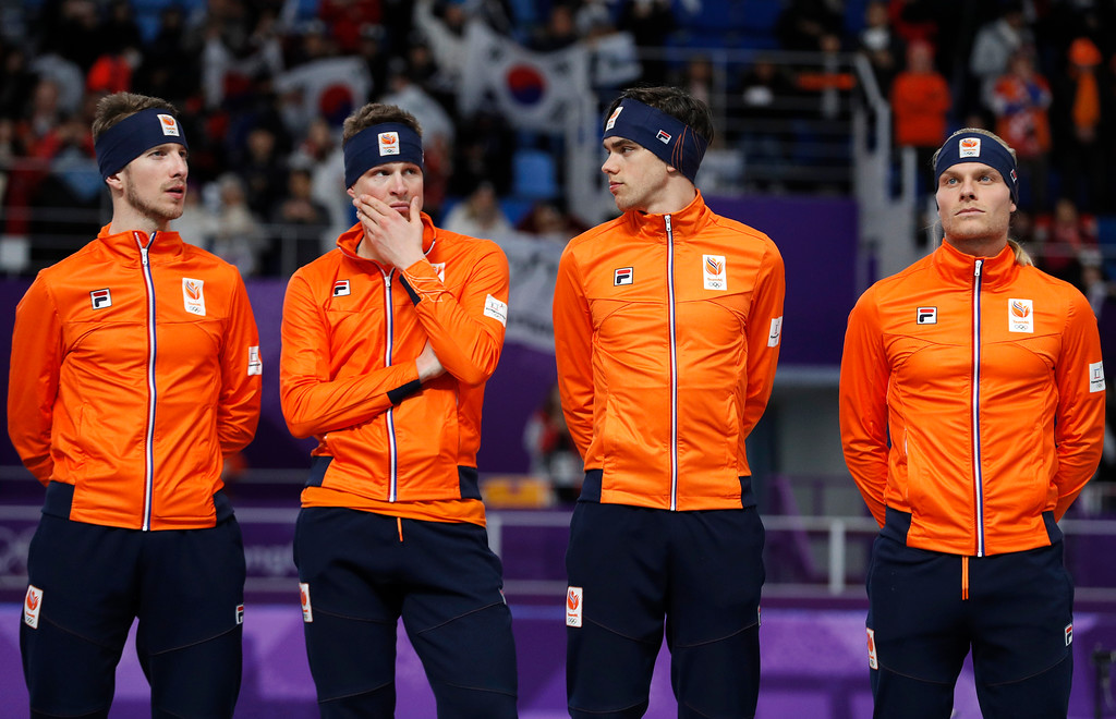 . Bronze medalist team Netherlands with Jan Blokhuijsen, Sven Kramer, Patrick Roest and Koen Verweij, from left to right, appear dejected on the podium after the men\'s team pursuit speedskating race at the Gangneung Oval at the 2018 Winter Olympics in Gangneung, South Korea, Wednesday, Feb. 21, 2018. (AP Photo/John Locher)
