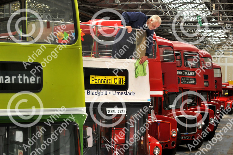 pic stand alone... Former bus conductor and volunteer at Swansea Bus Museum Nick Dasey dusting down an open top double decker made in the vintage summer of 1976. Plans are afoot at the end of the year to move the museum exhibits to a proposed new transport museum in Swansea.