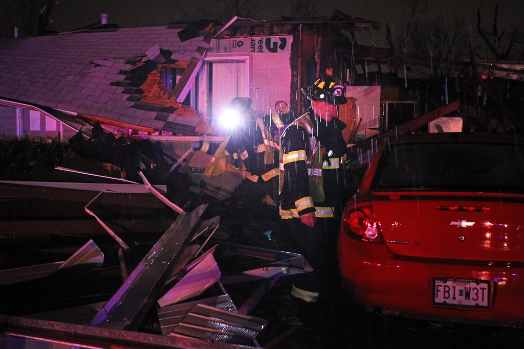 . Hazelwood Firefighters search a home on Howdershell Road next to Lynn Haven Lane following a strong spring in Hazelwood late Wednesday evening, April 10, 2013.   (AP Photo/Erik M. Lunsford, Post-Dispatch)